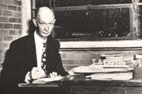 Antique photo of John A. Larson, the founder and president of Little Rock Junior College, at his desk.