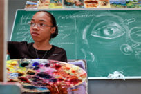 An art student painting in a class in the Windgate Center of Art and Design.