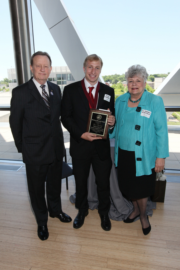 UALR Chancellor, Dr. Joel E. Anderson; Ryne Ramaker '12; Dr. Sandra Robertson '95