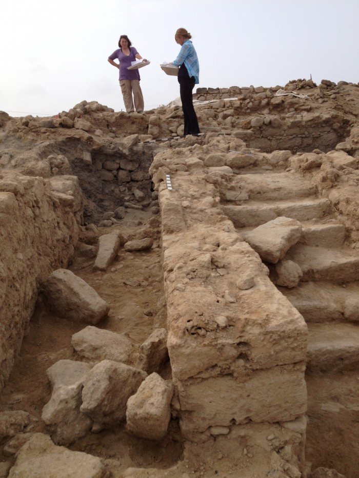 UALR Anthropology students Deanna Holdcraft and Susanne Crouch map the excavations at Al Baleed, Summer 2014.