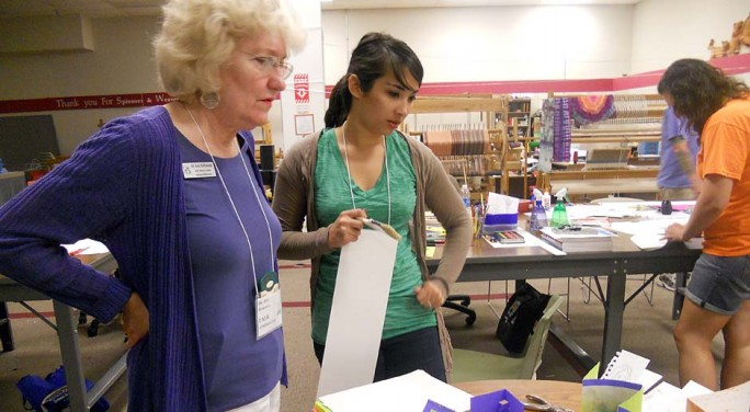 Gifted Program Director Ann Robinson looks over a project