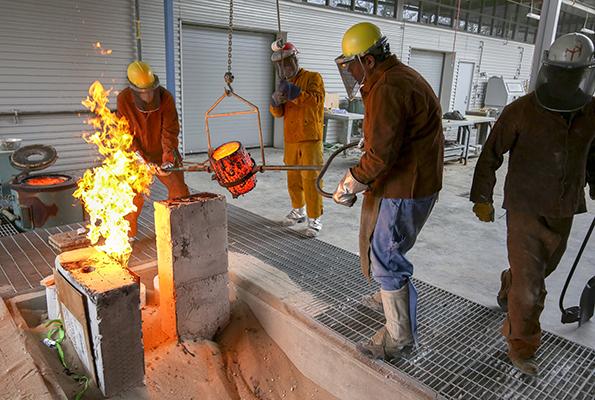 Students casting bronze