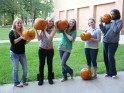5 girll holding up carved pumpkins