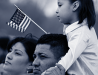 Image of Latino family waiving US flag