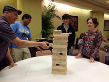 parents playing the game Jenga.