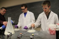 2 ACS students making nitrogen ice cream.