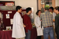 3 ACS Students talking to prospective students at the ACS Table at Discover UALR Day.