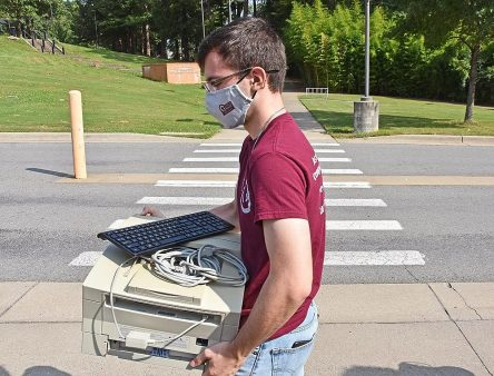 Student carrying computer equipment