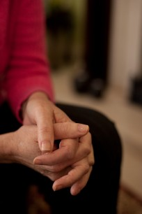 person with clasped hands
