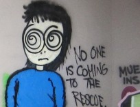 "graffiti of a bewildered person and text saying ""NO ONE IS COMING TO THE RESCUE"""
