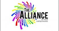 "Official log is the title ""The Alliance"" in large black text with a small tage line ""The Gay-Straight Connection"""", also in black, beneath it. A swirling or spinning wheel of dashed lines in the rainbow colors looks to explode out from the title making for a volorful and dynamic effect."