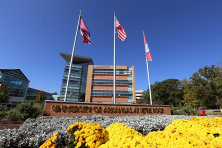 View of Student Services Center, and three flags: Arkansas, US and UA Little Rock