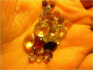 Photo of an open hand holding various gems. Photo by Sharon Kelley.