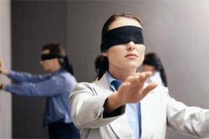 People in a room blindfolded, hands in front to feel their way