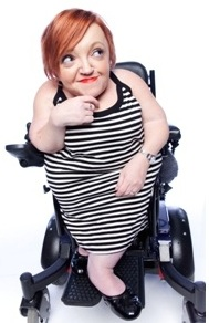 Stella Young in wheelchair, white background
