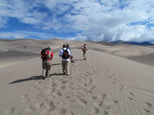 Walking the crest of a dune, Great Sand Dunes National Park and Preserve, Colorado