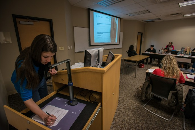 Dr. Sarah Quintanar teaching Business Statistics in a classroom