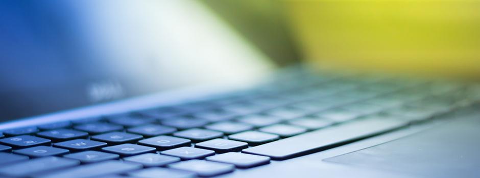Extreme close-up of laptop keyboard.