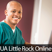 Black male nurse with laptop