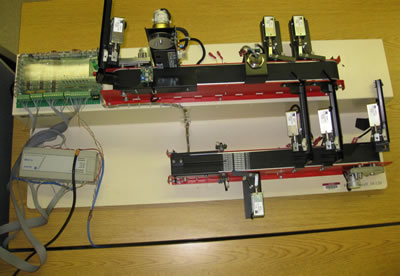 A mini-assembly line controlled by an Allen Bradley MicroLogix 1000 PLC (used in Robotics and PLCs class).