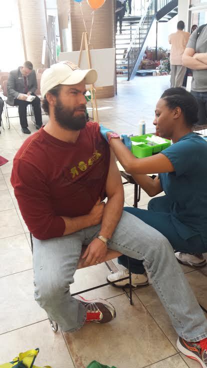 photo of a man getting a flu shot