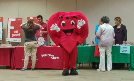 photo of person dressed in heart costume at the biometric screening in 2016