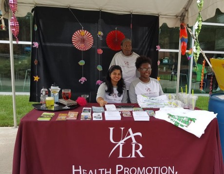 photo of UA Little Rock students at the health promotion table during Discover UALR