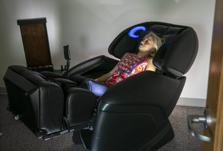 Photo of student sitting in massage chair