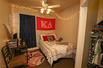 A bedroom in an apartment at the University Village.