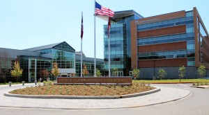 UA Little Rock Student Services Center with flags flying in front