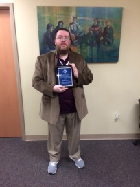 Justin Sangster with his teaching award
