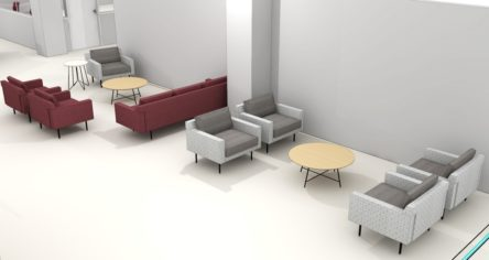 The collaboration areas, grouping of modern armchairs and couches upholstered in grey and red, grouped around light wood coffee tables.