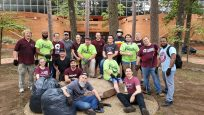 Group photo of 19 ITS volunteers on their campus cleanup effort.