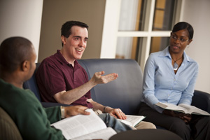 Professor Josh Silverstein discusses class with students.