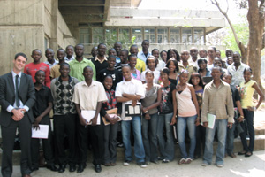 Professor Nick Kahn-Fogel poses for a photo with students from the law school at the University of Zambia.