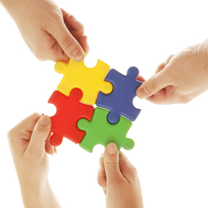 Hands put together a puzzle that's symbolic of putting together a plan for a student's education.