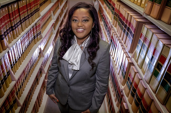 Photo by BENJAMIN KRAIN —05/04/18--.Liz Harris is a litigation law clerk at the Arkansa Municipal League during the day and a part time law student at the UA Bowen School of Law at night. Harris will be graduating in Spring 2018