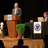 Photo of Daniel Breen and Jacob Kauffman at the debate.