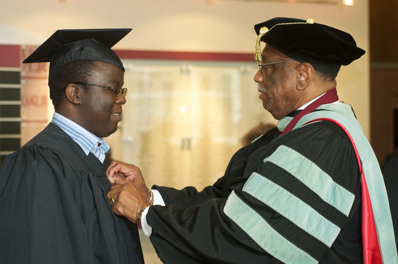 Rwandan Student with Dr. Charles Donaldson, vice chancellor of educational services and student services