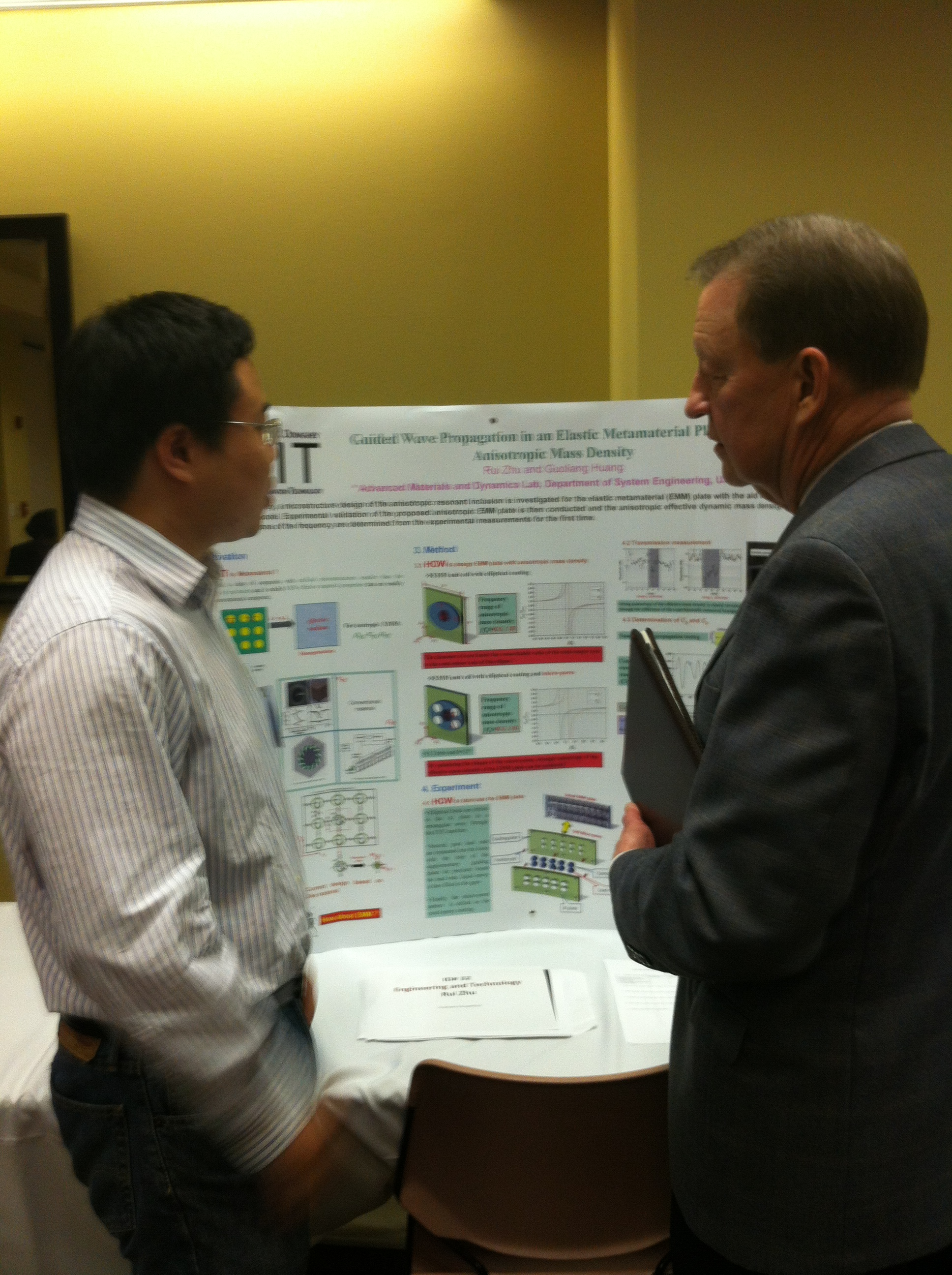 Chancellor Joel E. Anderson and Student at UALR Student Research and Creative Works Expo
