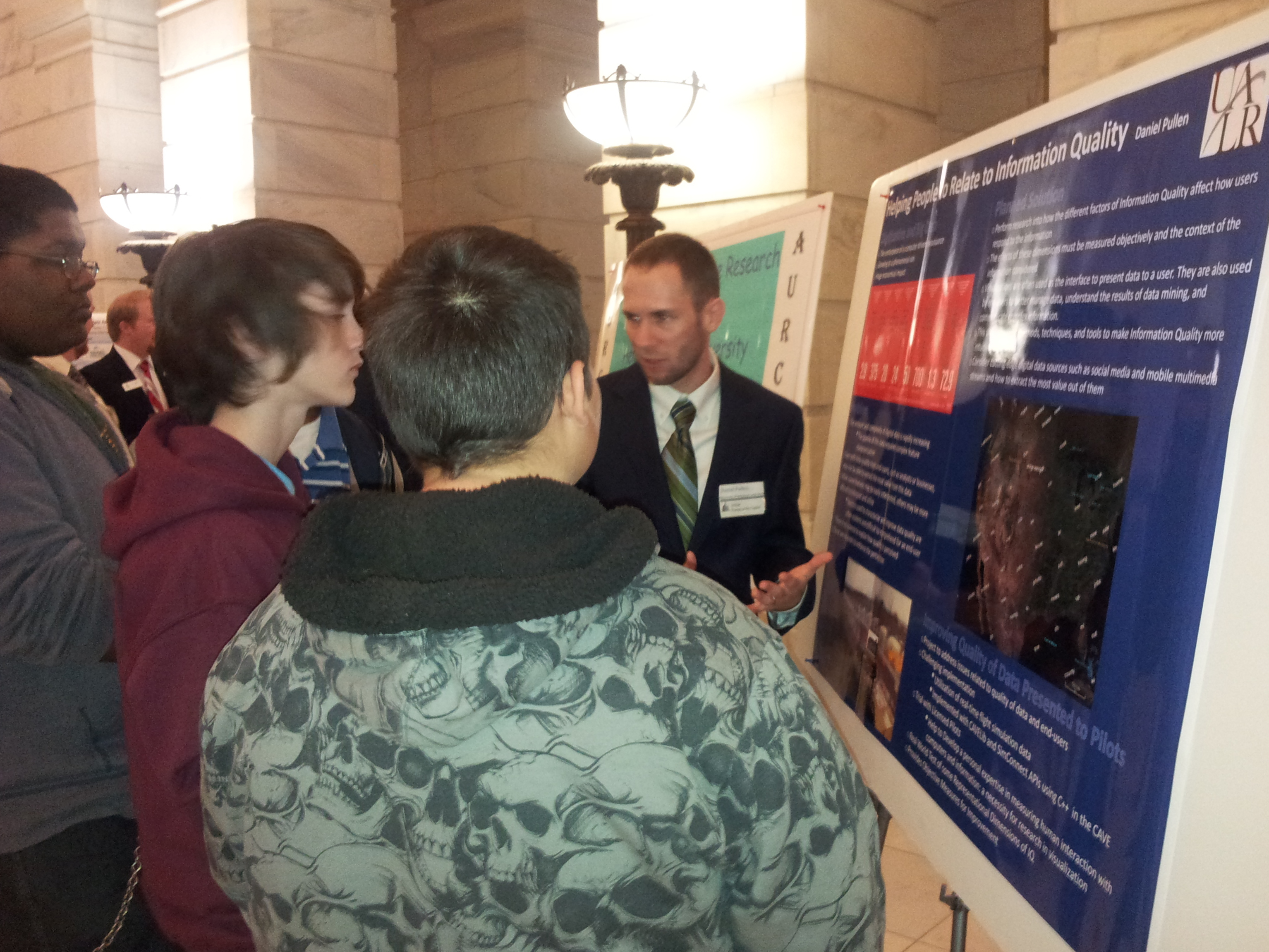 Daniel Pullen speaks to students about his research at STEM Posters at the Arkansas State Capitol 2013