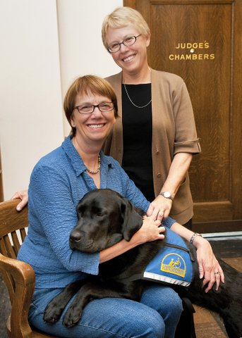 Molly the Court House Dog with owners Ellen and Celleste