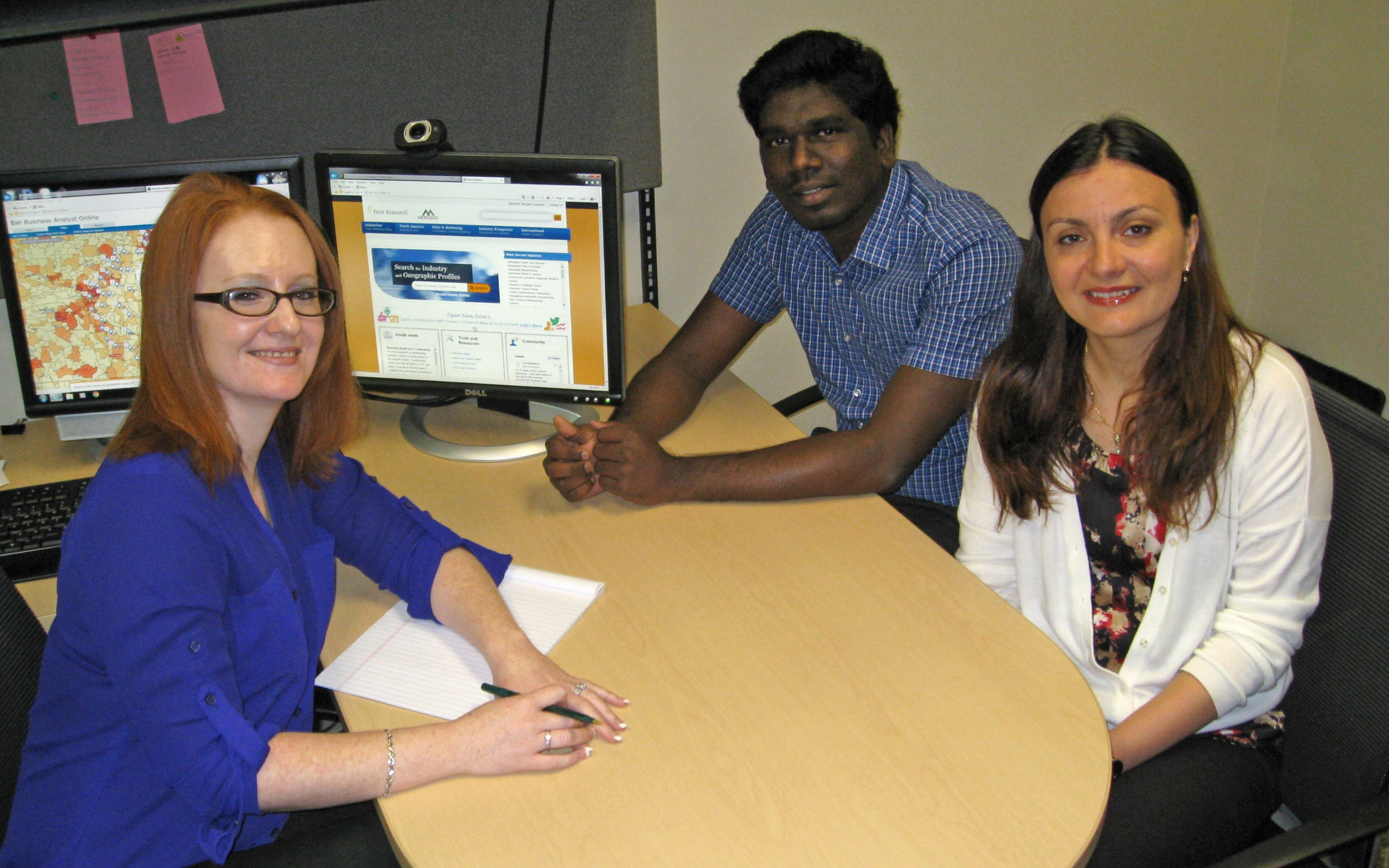 Graduate assistants in the UALR Arkansas Small Business and Technology Development Center are (from left) Anita Wheetley, Leo Albert Lobo and Gabriela Biris.