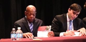 U.S. Rep. John Lewis signs copies of his book with co-writer Andrew Aydin