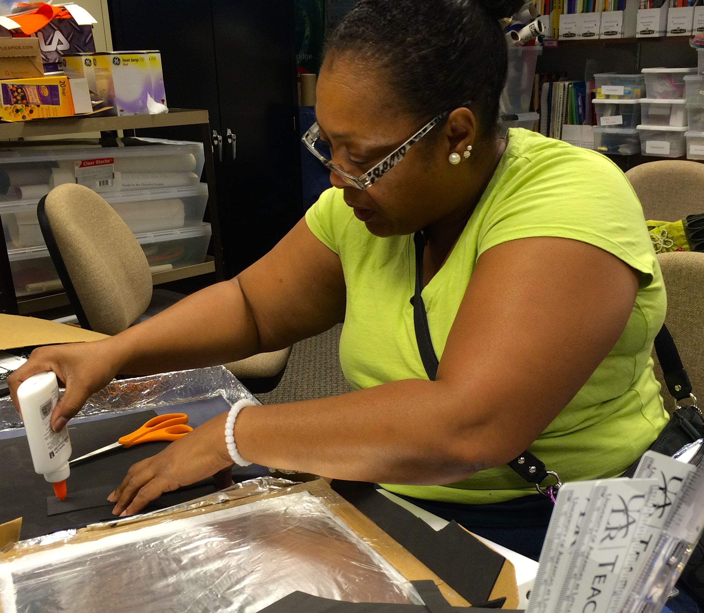 Yvonne Bolden of Mann Magnet Middle School learns to build a solar oven during a STEM camp for teachers at UALR.