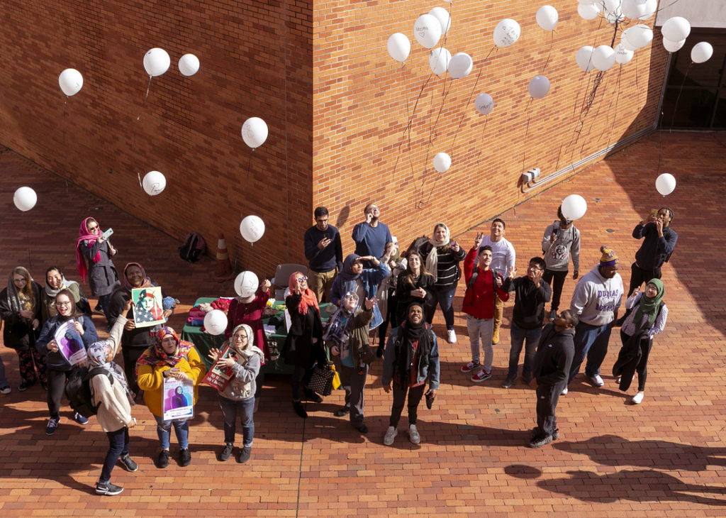 The campus community released white balloons of love and hope in honor of women who have been victims of physical attacks and policy discrimination because of their choice to wear the hijab. Photo by Ben Krain.
