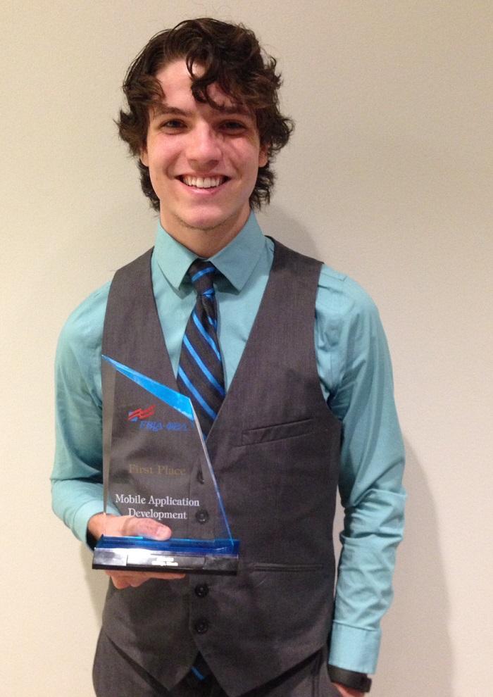 UALR student, Alec Crow, holds first place award