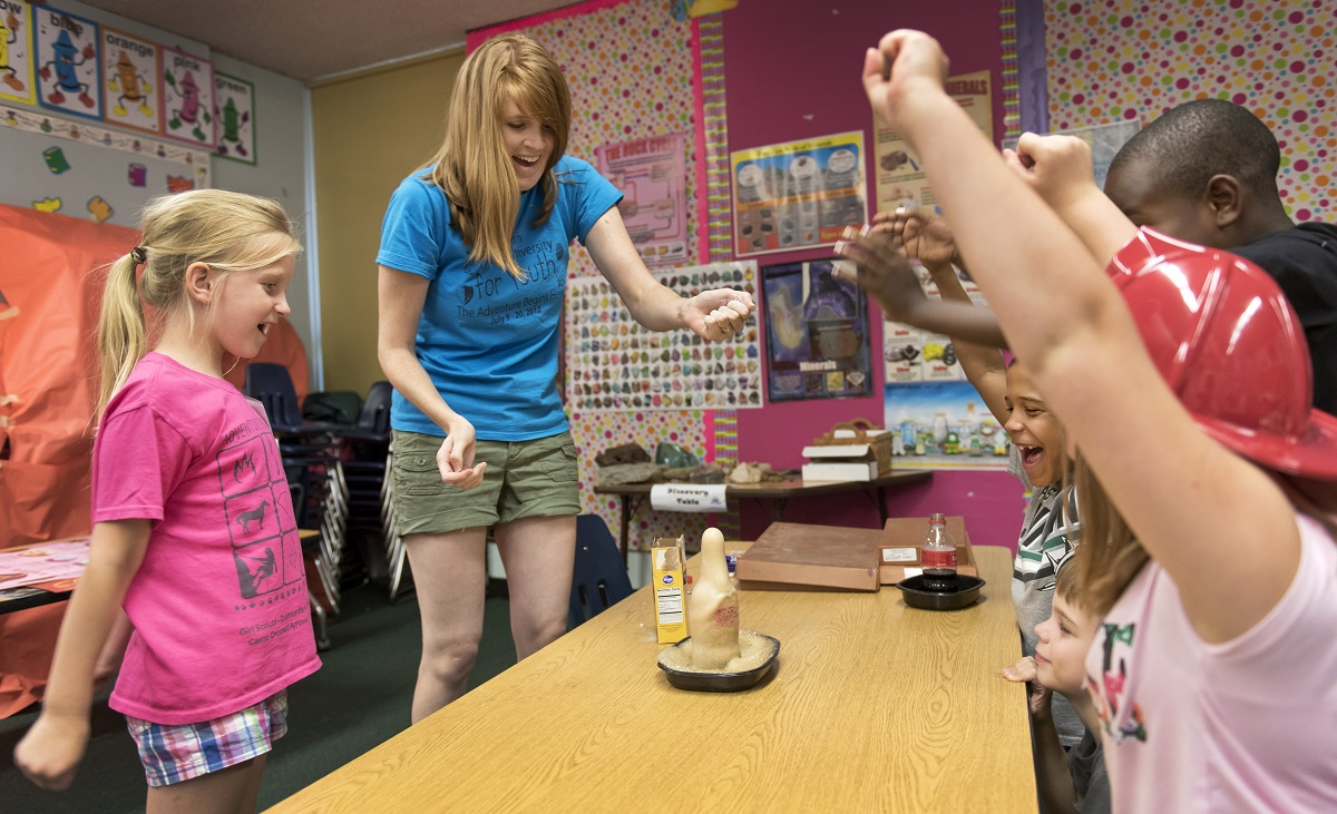 Children react as teacher April Blackburn combines baking soda with Coke