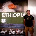 James Sellers poses in front of an Ethiopia sign