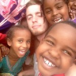 James Sellers surrounded by students during a missions trip to Ethiopia